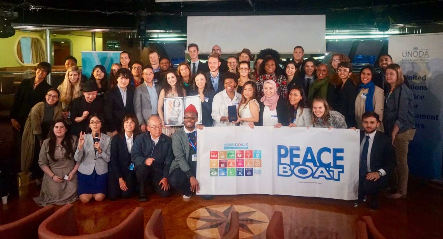 "Posing with other participants in ""Youth Champions for Securing our Common Future"" (Photo credit: UNODA)."